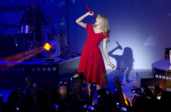 "Taylor Swift, shown during an appearance Nov. 6 in London, remains at No. 1 on the nationals sales chart with her ""Red"" album."