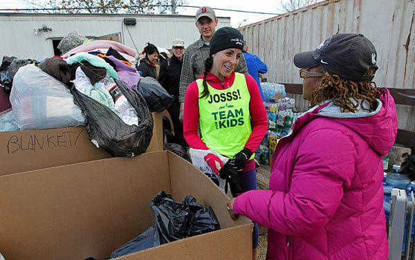 A runner who would have run the New York City Marathon (Nov. 4) instead, spends that afternoon volunteering to help those who lost housing.