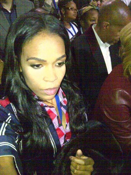 "Former Destiny's Child singer Michelle Williams appears to take a picture of herself at Obama's rally. ""#MOVINGFORWARD Election Night Rally in Chicago, IL,"" Williams tweeted. ""The energy is INCREDIBLE!"""
