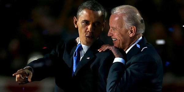 President Barack Obama and Vice President Joe Biden share a moment at the election night party at McCormick Place in Chicago early Wednesday morning.  (Scott Strazzante, Chicago Tribune)