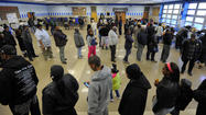 State officials are investigating complaints about long lines at polls that left some voters waiting for two hours on Election Day despite lower than expected turnout.