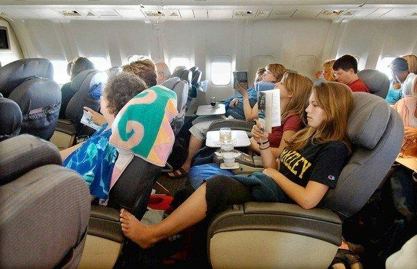Business-class passengers on a United Airlines flight to Hawaii.
