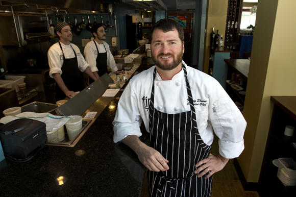 Chef Kenny Sloane of Fin restaurant wins Signature Chefs Auction