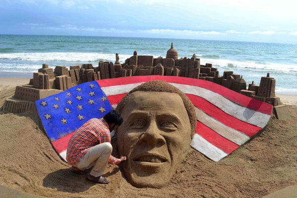 Indian sand artist Sudaran Pattnaik gives the final touches to his sand sculpture of reelected President Obama at Golden Sea Beach in Puri, India.