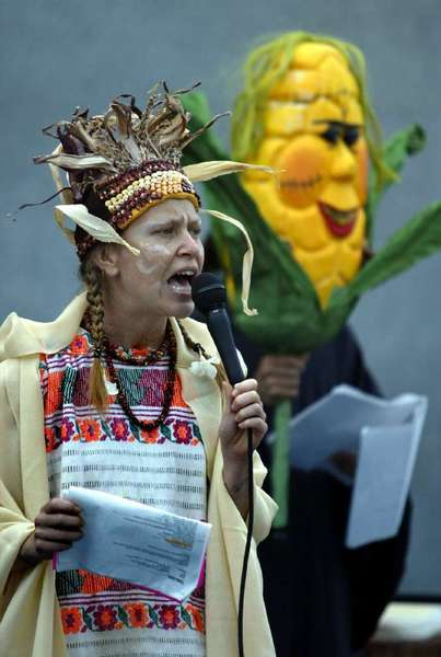 A protester in Sacramento speaks out against genetically modified corn.