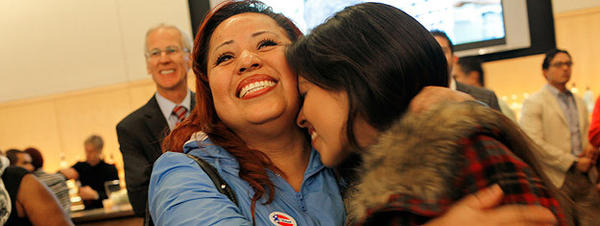 Vivian Leon, left, embraces her daughter Ashley Lomelin upon hearing that President Barack Obama won re-election at Dodger Stadium.