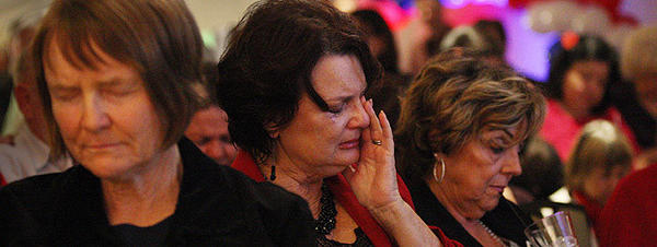 Republicans Carole Cole, left, and  Karen Jerpseth, center, weep after hearing President Obama had won Ohio.