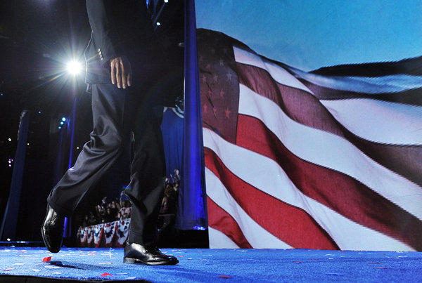 President Obama walks off the stage following his victory speech on election night in Chicago.