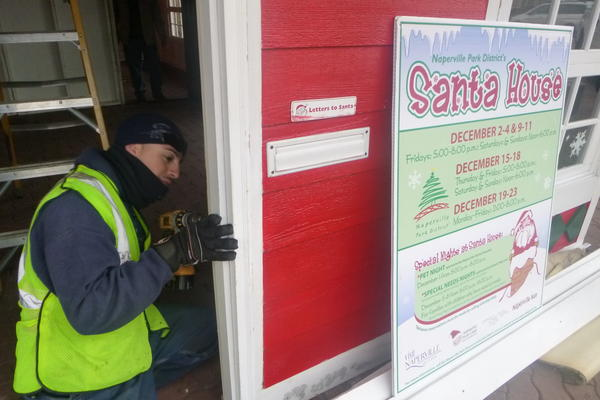 Naperville Park District employee Israel Ruiz, of Naperville, was one of the workers who assembled the Santa House along the downtown Riverwalk Wednesday morning.