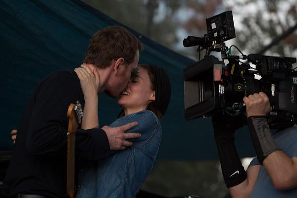 Michael Fassbender and Rooney Mara kiss on stage while filming the untitled Terrence Malick movie during the Fun Fun Fun Fest in Austin, Texas.