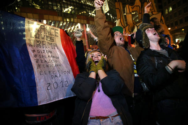 People celebrate after CNN projected President Barack Obama as the winner during an election watching rally outside the Thompson Center in downtown Chicago on Tuesday, November 6, 2012.