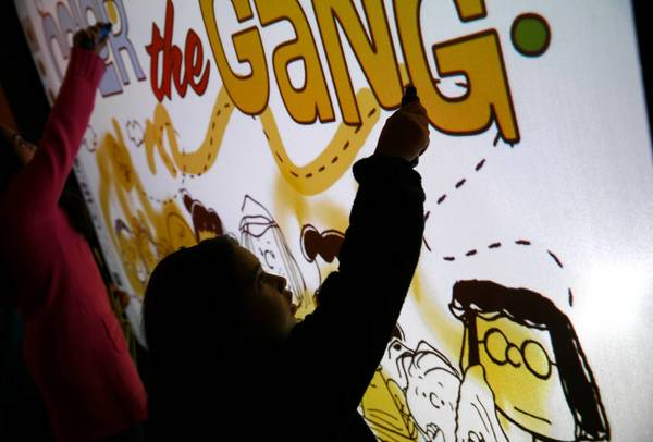 Brianna Gonzalez, 8, of East Chicago, In., with an interactive feature of the new Charlie Brown exhibit at Museum of Science and Industry.