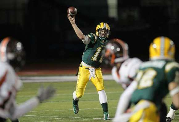 Edison's Aleksander Torgersen throws downfield during a Sunset League game against Huntington Beach.