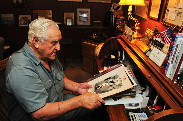 George Mendonsa, 89, holds one of the most iconic photographs of the 20th century at his Middletown, Rhode Island home. In the photograph, Mendonsa is widely believed to be the sailor kissing an unsuspecting nurse (actually a dental hygenist) on V-J Day in Times Square in 1945. The photograph was taken by Life Magazine photographer Alfred Eisenstaedt.