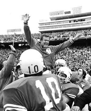 This Jan. 1, 1973 file photo shows Texas coach Darrell Royal being carried off the field by his players after the Longhorns defeated Alabama, 17-13, in the Cotton bowl.