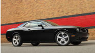 Authorities seek black Dodge Challenger in fatal hit and run