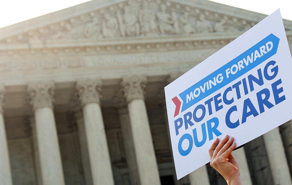 A supporter of the Affordable Care Act carries a sign outside the Supreme Court building in 2012.