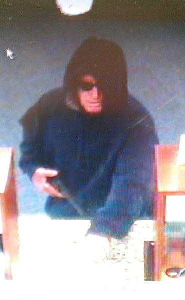 The FBI is searching for the hooded gunman who robbed the First Southern Bank in Coral Springs