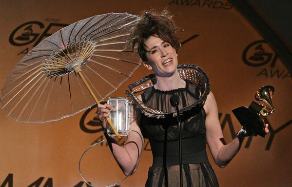 "British singer-songwriter Imogen Heap turned heads on the carpet with her eccentric and forward-thinking attire. Around Heap's neck: a kind of sculptural cuff with blinking lights, and her purse was a small television. ""This necklace has a live Twitter feed,"" Heap explained. ""I've got a wireless router here, which is heating up my belly nicely. And here's a television with videos my fans are sending to my account. Now they're accompanying me down the red carpet."" Naturally, her outfit, deemed ""Immi's Twitdress,"" had its own Twitter feed."