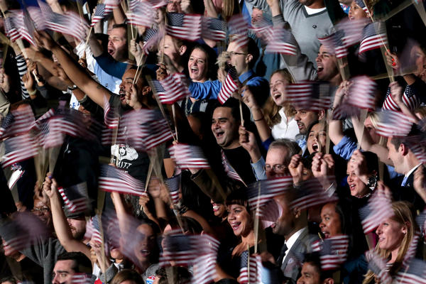 Supporters of President Barack Obama cheer as they wait for the president to appear on stage for his victory speech early Wednesday morning in Chicago.