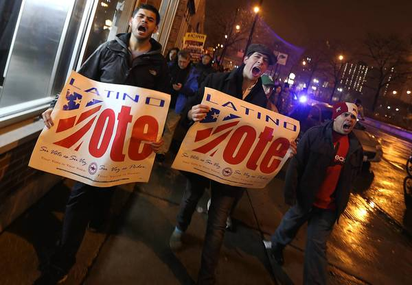 Immigrants rights advocates march on election night near McCormick Place in Chicago, where President Obama gave his victory speech.