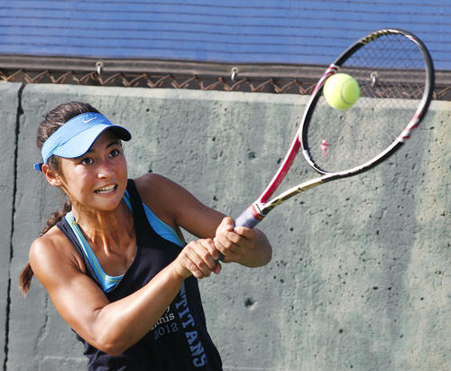 San Marino's Devon Jack strongly double backhand returns a shot in a singles match against Claremont in the semifinals of the CIF Southern Section Division II playoffs at San Marino High School on Wednesday, November 7, 2012.