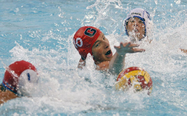 Glendale's Arman Momdzhyan, center, fights for the ball during the CIF Southern Southern Section Division V playoffs against JW North, which took place at Burbank High School on Wednesday, November 7, 2012.