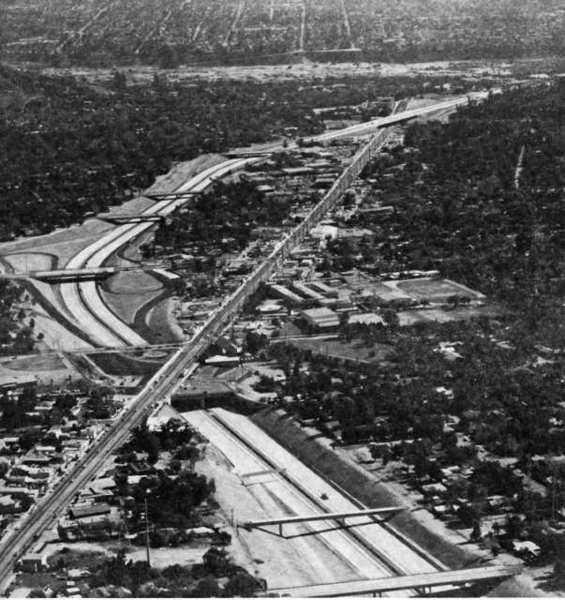 This aerial shot of the Foothill Freeway was taken in early November 1972, a few weeks before the freeway was completed and opened to traffic. The view is eastward, with the Arroyo Seco and Altadena in the background. The large campus in the center is on Cornishon Avenue. It then housed Foothill Intermediate School, but is now the headquarters for the La Canada Unified School District, which rents out some of the facilities to private schools.