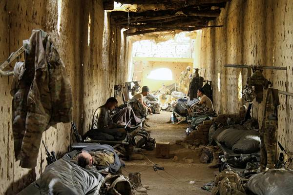 American troops who staff a checkpoint with Afghan police spend nights in a thick-walled mud structure once used to dry grapes. It overlooks a village that remains hostile to U.S. forces, and the troops also must be on guard against a possible insider attack.