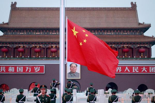 Members of the People's Liberation Army lower the flag on Tiananmen Square during a ceremony at the Gate of Heavenly Peace on the eve of the 18th Communist Party of China Congress in Beijing, China.