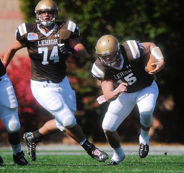 Lehigh's QB Michael Colvin (right) looks for room to run against Bucknell's defense at Goodman Stadium Saturday afternoon October 20, 2012.