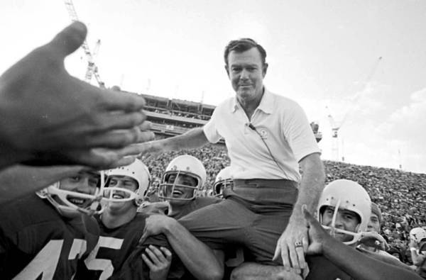University of Texas Coach Darrell Royal is carried from the field on the shoulders of his Longhorns after a 1970 game.