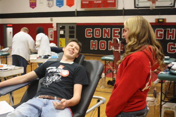 Conemaugh Township senior Jeremy Sotosky donates blood during a drive sponsored by the senior high student council, while junior Megan Boyer looks on.