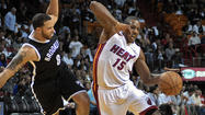Photos: Heat 103, Nets 73