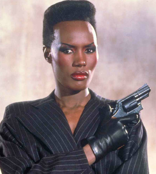 From Honey Ryder to Strawberry Fields: The ultimate guide to Bond girls: The movie: A View to a Kill The actress: Grace Jones Character type: Henchwoman and assassin Cringeworthy name factor: Good or evil?: Bad girl gone good Ultimate fate: Blown up after she switches sides and saves Silicon Valley from her boss/boyfriends attempt to trigger a massive earthquake with two huge bombs.  Distressed damsel or Bond-worthy badass?: She throws a guy off the Eiffel Tower, parachute off the monument, and manhandles a ginormous bomb onto a handcar and drives it into a mine. Plus, shes played by Grace Jones. Total badass.