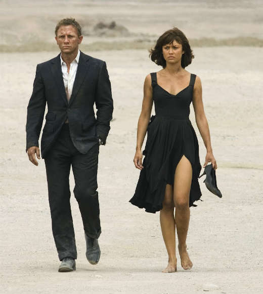 "<b>The movie:</b> ""Quantum of Solace""<br> <b>The actress:</b> Olga Kurylenko <br> <b>Character type:</b> Vengeful South American spy<br> <b>Cringeworthy name factor:</b> Low<br> <b>Good or evil?:</b> Good<br> <b>Ultimate fate:</b> She kills the man who murdered her parents and gets a kiss from Bond.<br> <b>Distressed damsel or Bond-worthy badass?</b>: She lives her life for revenge -- and gets it. Plus, she's one of the few women to resist Bond's seduction technique, which is badass... but not a choice most women would make."