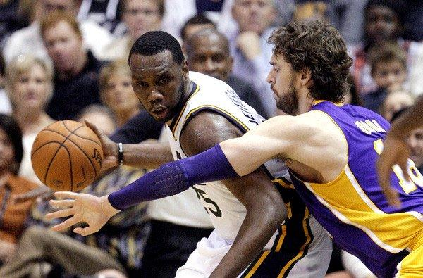 Lakers power forward Pau Gasol tries to cut off a drive by Jazz center Al Jefferson in the first half Wednesday night in Utah.