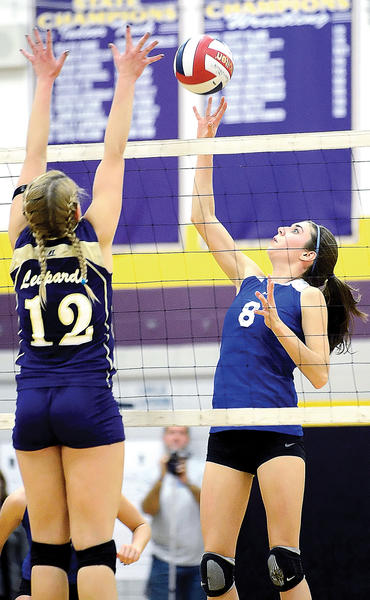 Boonsboros Maggie Sullivan (8) attempts a tip over the block of Smithsburgs Haley Caudell (12) during Wednesday nights Maryland Class 1A West volleyball semifinal at Smithsburg.