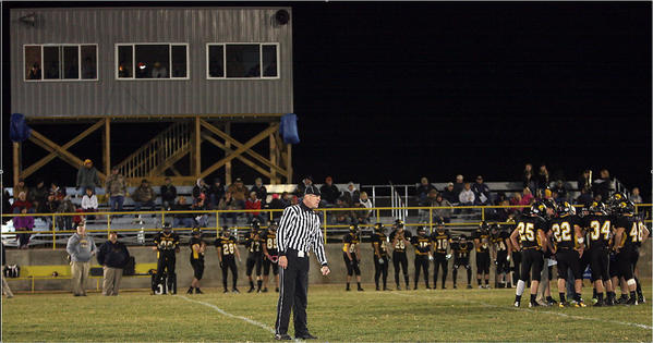 Members of the Faulkton football squad stand in front of a set of bleachers, that have been raised for better viewing for fans, and below a brand new press box. The athletic complex also received new dirt to level the field and a sprinkler system. This past fall, the Trojans hosted their first playoff game at the facility since 1998.