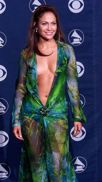 "The plunge. Jennifer Lopez wore an exotic green Versace silk chiffon dress to the 42nd Grammy Awards with a neckline that went so far down (below the navel) that it had many wondering how she ""kept it all in,"" so to speak."