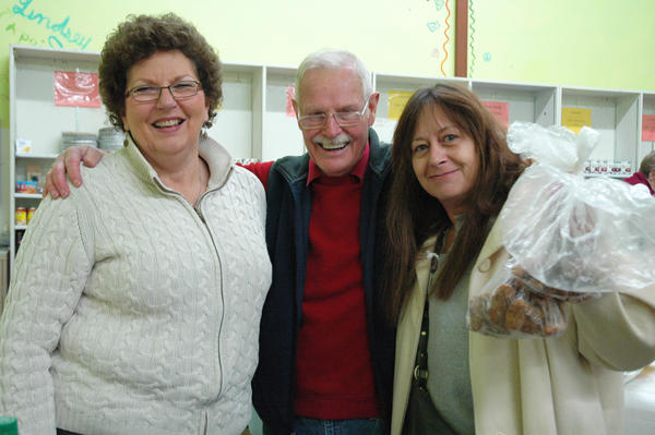 Kathy Hart, executive director of Manna Food Project, volunteer Keith Engstrom of Petoskey and Laura Eedy of Petoskey pause for a picture at the Manna distribution center and pantry in Harbor Springs.