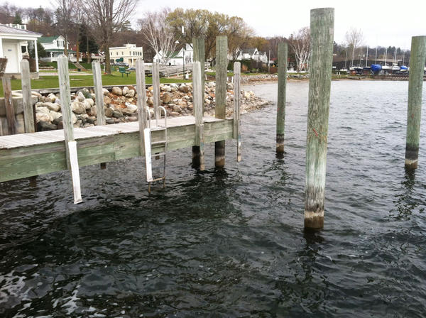 Low Great Lakes water levels are requiring Harbor Springs to lower the level of its docks in the city marina.