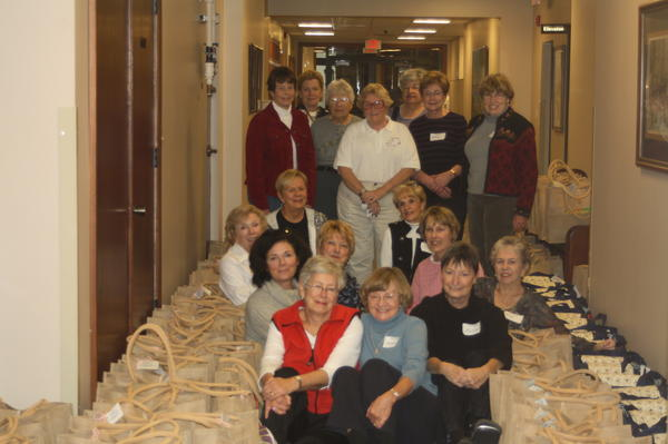 Members of the Christ Child Society gather recently at Birchwood Country Club in Harbor Springs to assemble more than 300 layettes for children born in area hospitals who are in need of assistance.