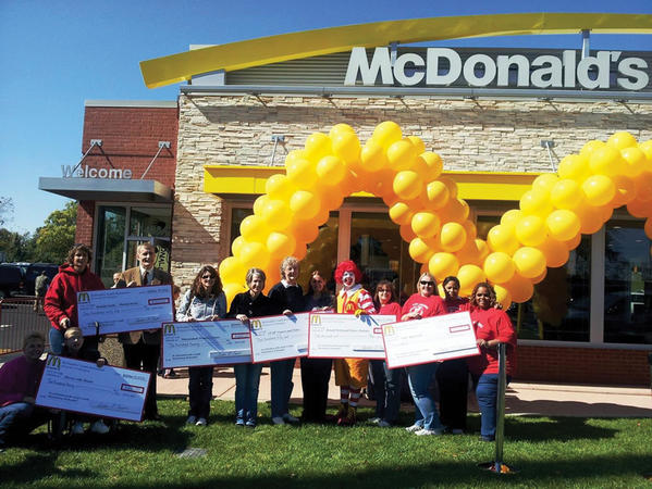 McDonalds franchisee Susan Erwin, accompanied by Ronald McDonald, presented donations to Martinsburg, W.Va., community organizations, including the Ronald McDonald House Charities, on Oct. 13.Pictured from left are Kay Barkwill, Horses with Hearts; Brenden Dugan; Cathy Dodson, instructor and co-founder, Horses with Hearts; John Overington, Berkeley County Humane Society; Teresa Shumate, assistant director, Shenandoah Women's Center; Linda Jenkins, Shenandoah Womens Center; Melanie Files, volunteer with CCAP/Loaves and Fishes; Susan Erwin, McDonald's franchisee; Ronald McDonald; and Mary K. Iden, Tina Dorsey, Deborah Valentine and Regina Terry-Jackson with Lady Appleseeds.