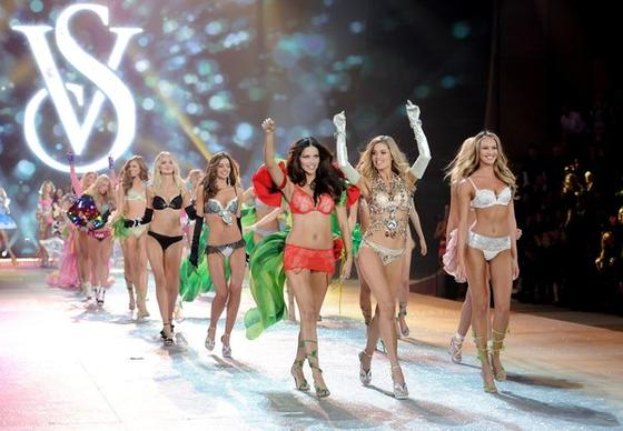 Models Adriana Lima, left, Doutzen Kroes and Candice Swanepoel lead the final runway walk during the 2012 Victoria's Secret Fashion Show.
