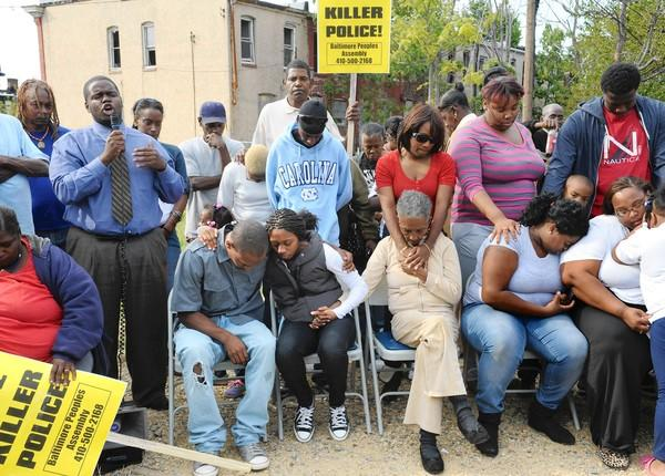Rev. Cortly C.D. Witherspoon, at left, ends protest and press conference with a prayer.