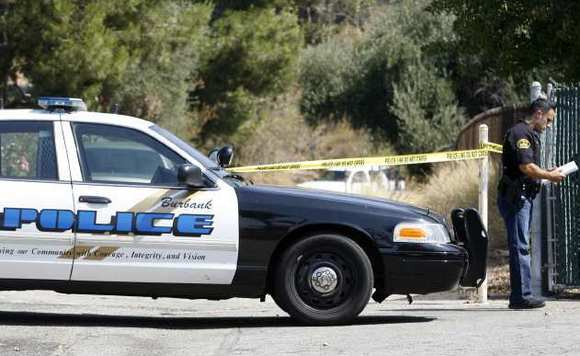 Burbank Police guard the area where a body was found on a trail behind St.Francis Xavier Church in July 2012.