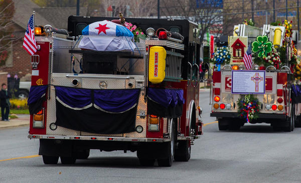 A funeral procession for Capt. Herbert Johnson of the Chicago Fire Department passes the Mt. Olivet Catholic Cemetery en route to funeral services in Chicago.