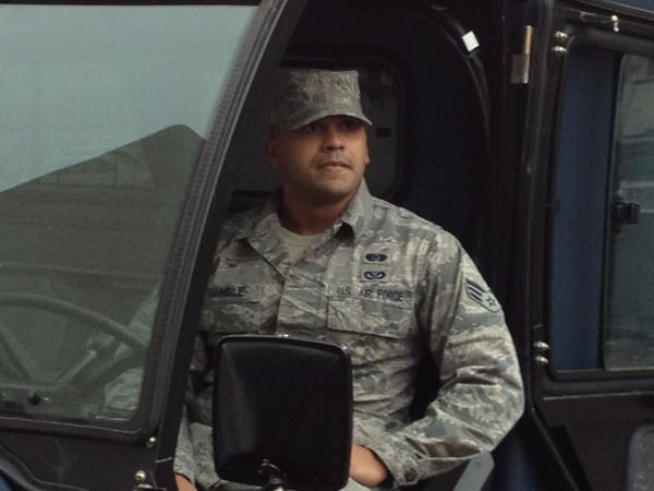 Former Newington high running back, now senior airmAn Steven Chamble in his hazmat emergency response vehicle. Chamble's unit is air force equivalent of FEMA - must be ready to deploy in 24 hrs. To any disaster-stricken area around the world.