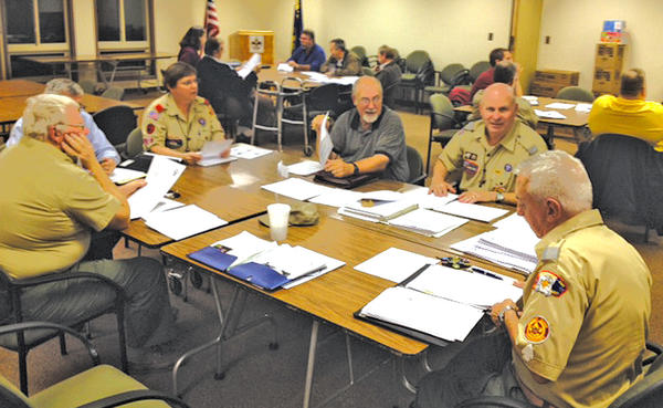 The commissioner staff of the Washington County District, Mason-Dixon Council, discuss the Scout show, Pictured, clockwise from bottom right, are Joseph Bach, district commissioner; Les Braun, commissioner; Fred Nugent, district membership chairman; Linda Zittle, commissioner; John Danko, commissioner; and Gary Stewart, commissioner.